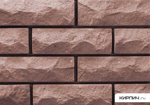 Так выглядит Кирпич силикатный облицовочный одинарный рустированный угловой коричневый на фото
